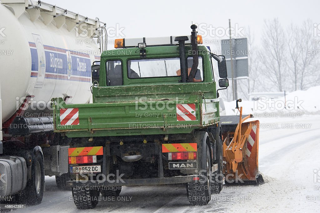 Snow plow in Riezlern, Austria. Bad road conditions. royalty-free stock photo