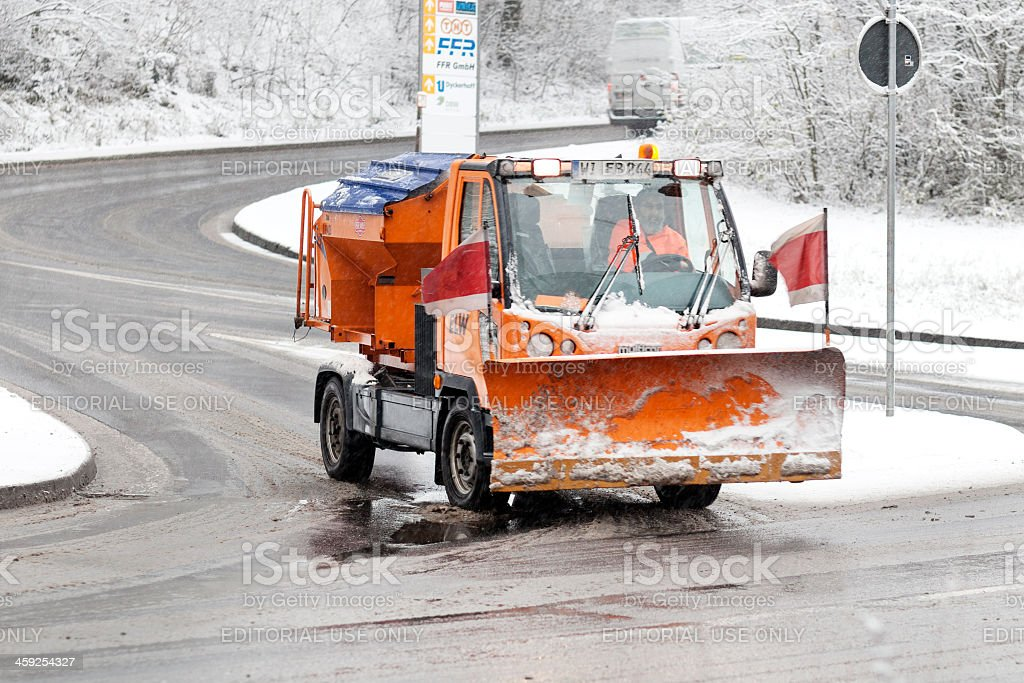 Snow plow mini truck - winter road conditions royalty-free stock photo