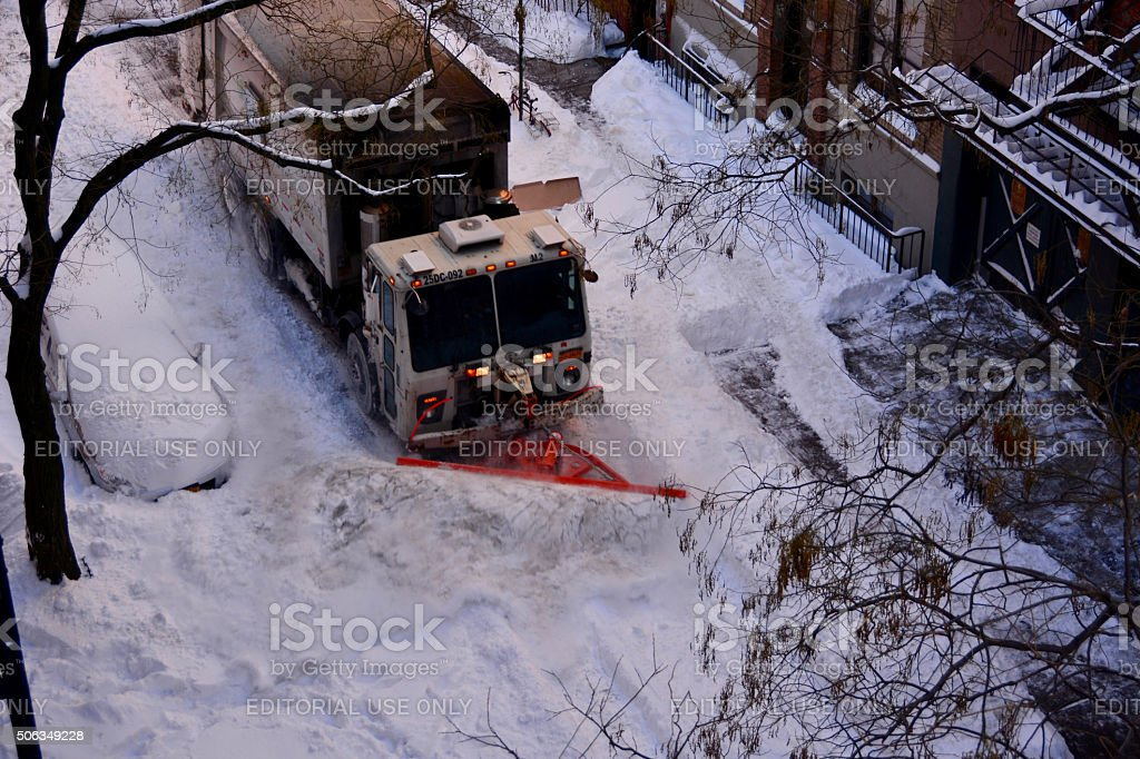 Snow Plow Plowing the Road the day after stock photo