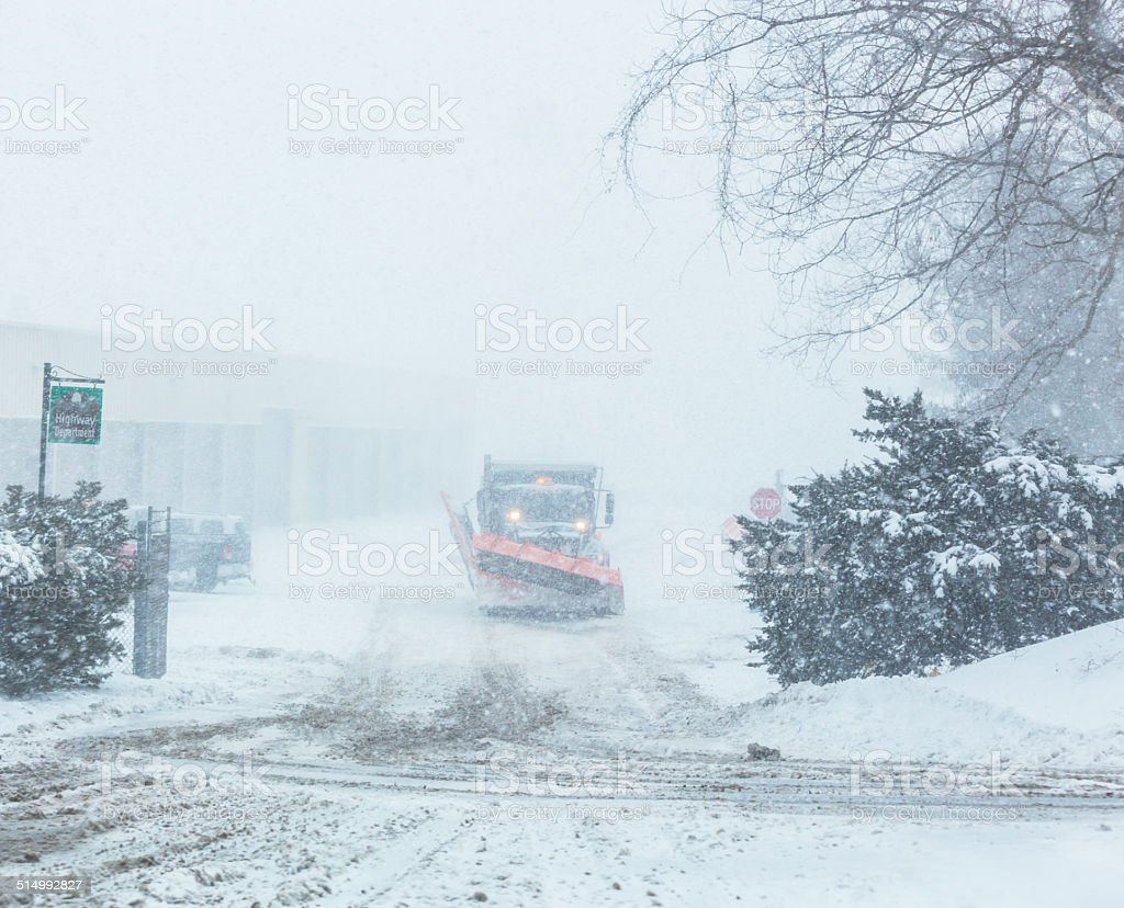 Snow Plow Truck Leaving Highway Department Parking Lot stock photo