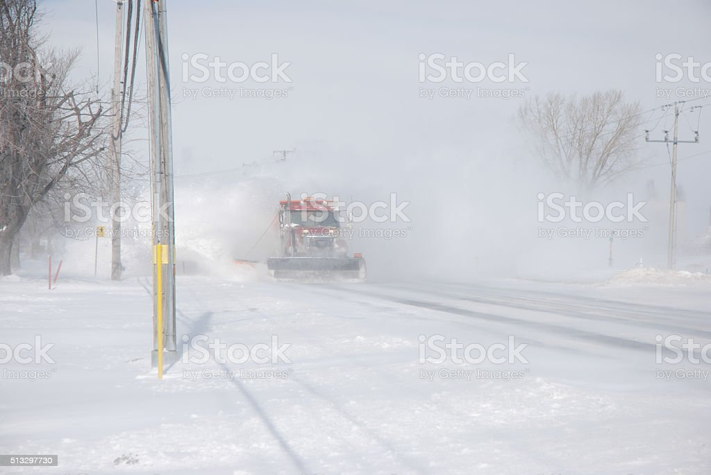 Snow plow truck on road. stock photo