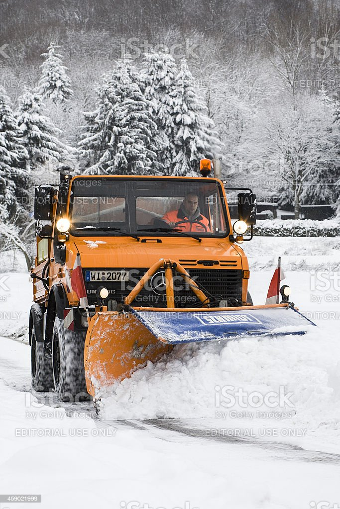 Snow plow - winter road conditions royalty-free stock photo