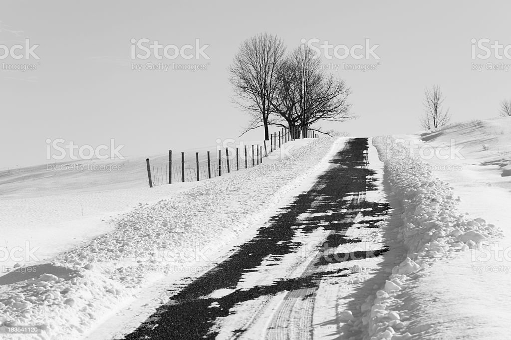 Snow Plowed Rural Gravel Country Road - BW stock photo