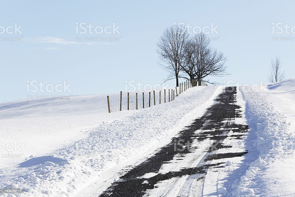 Snow Plowed Rural Gravel Country Road stock photo