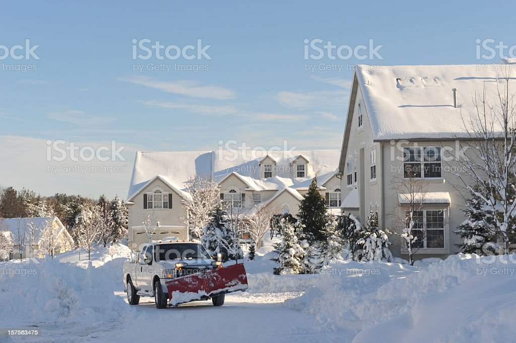 Snow Plowing Truck in Action stock photo