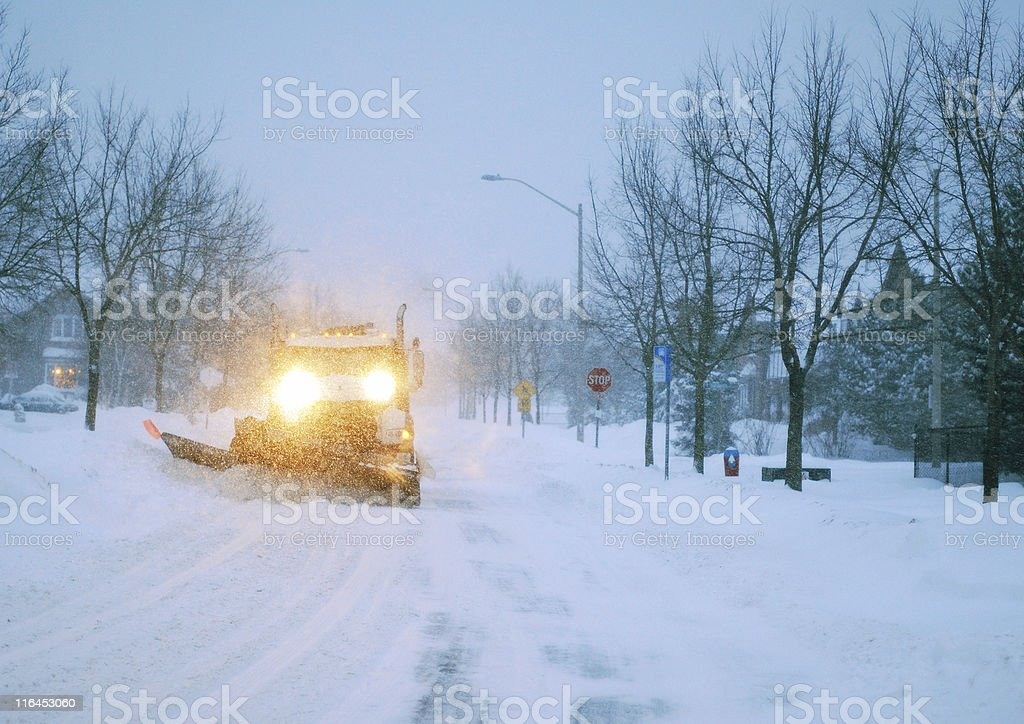 Snow plowing truck stock photo