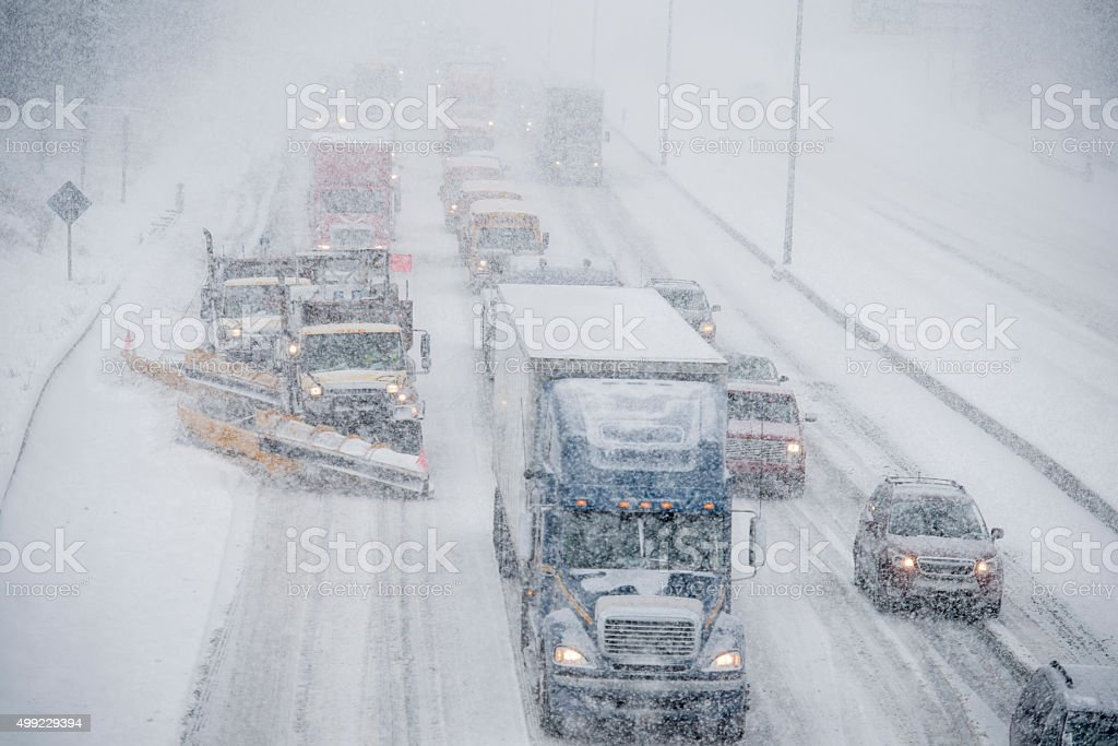 Snow Plows Clearing the Freeway stock photo