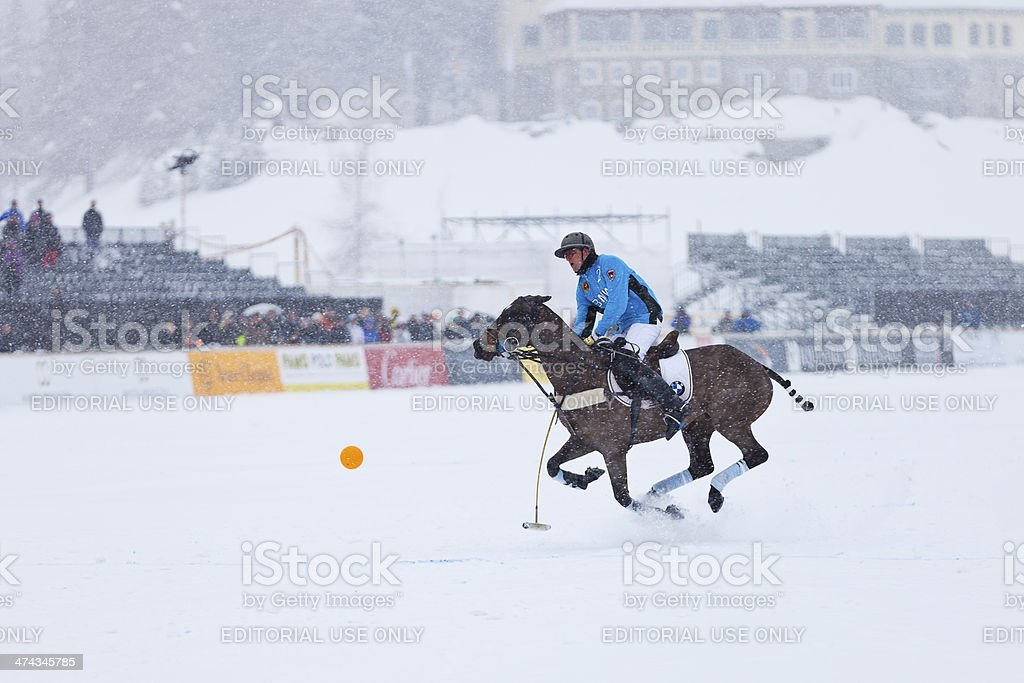 Snow Polo Player Galloping stock photo