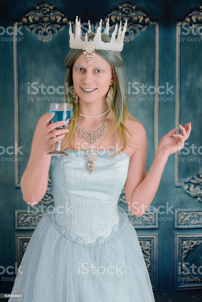 snow princess holding a drink stock photo