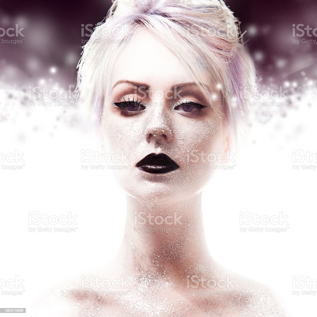 Snow Queen, creative closeup portrait of girl with black lips stock photo