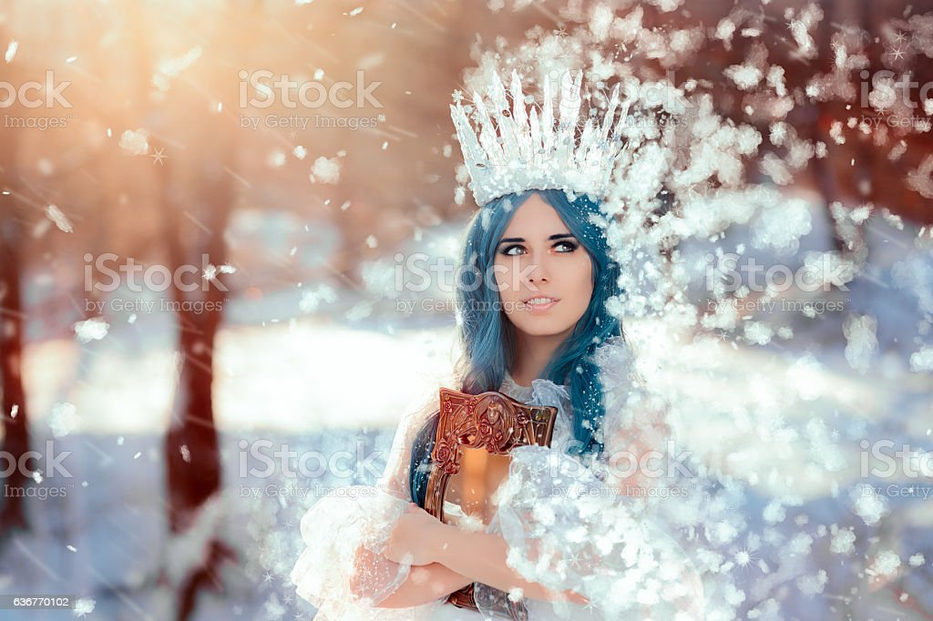 Snow Queen Holding Mirror in Winter Fantasy stock photo
