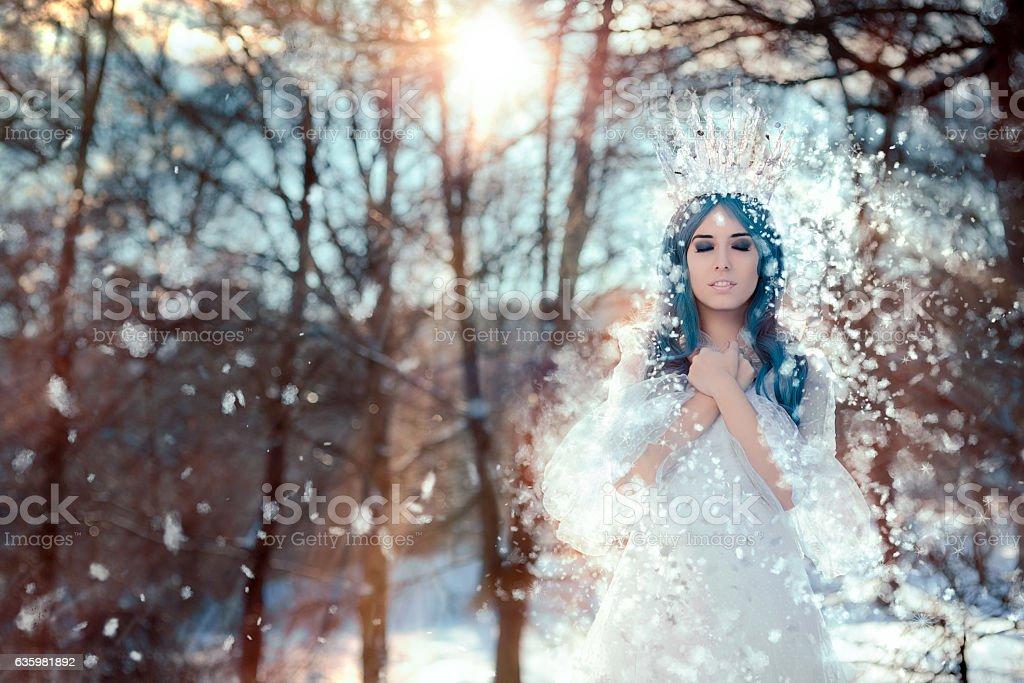 Snow Queen in Winter Fantasy Landscape stock photo