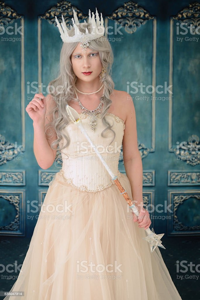 snow queen with wand and crown stock photo