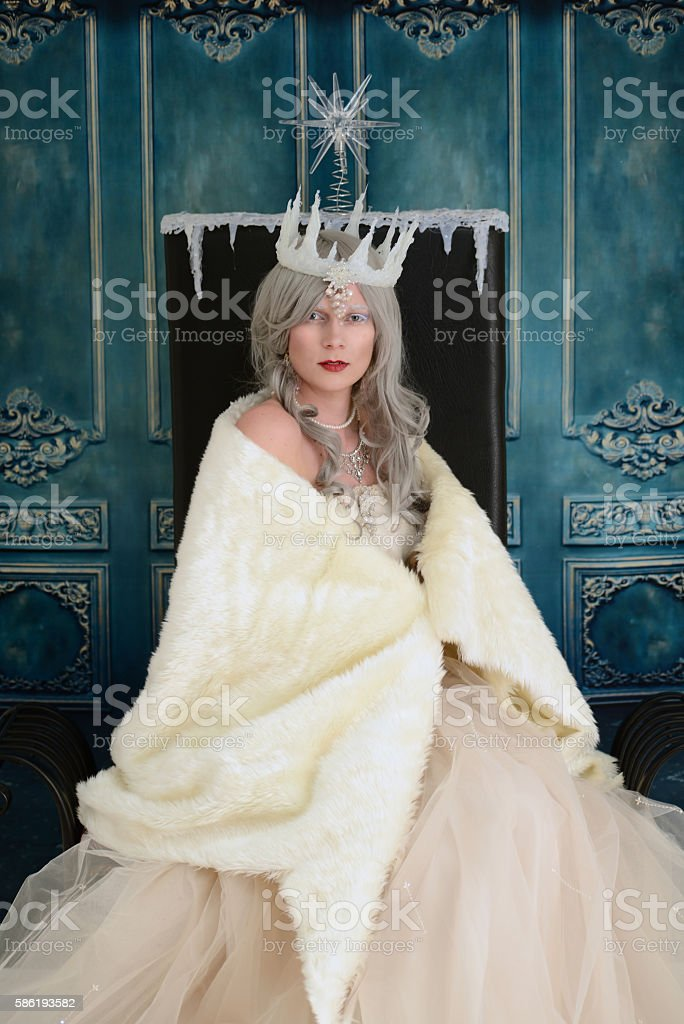 snow queen wrapped in fur cloak stock photo