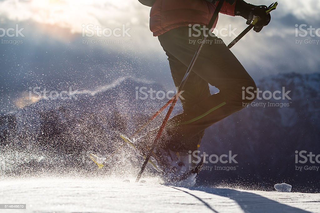 Snow raised by a man walking with snowshoes. stock photo