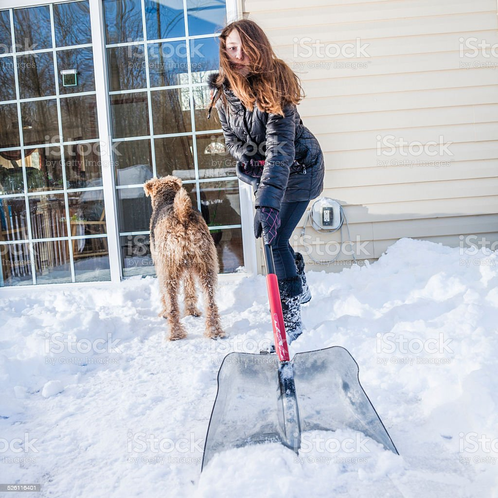 Snow removal at the desk stock photo