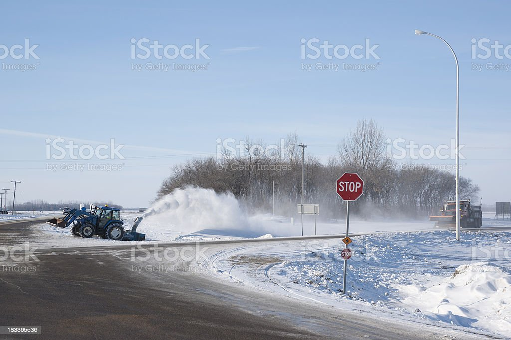 Snow Removal Equipment at Work on Remote Country Roads royalty-free stock photo