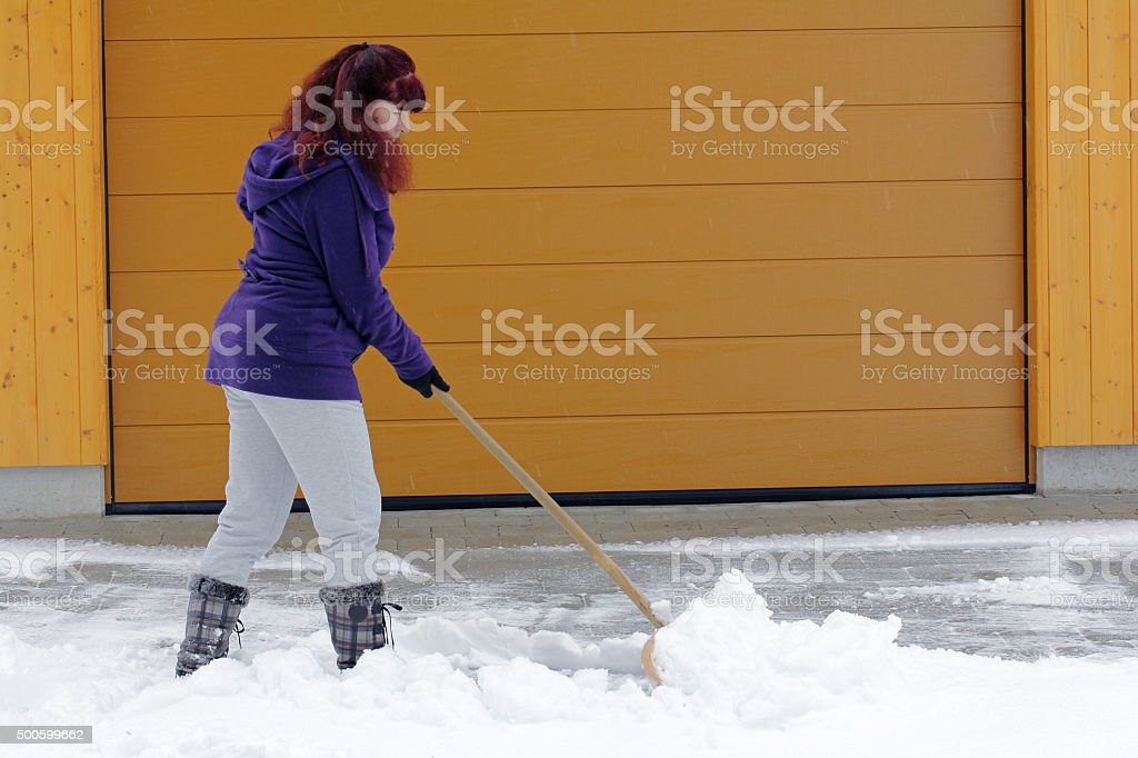 Snow removal in winter stock photo