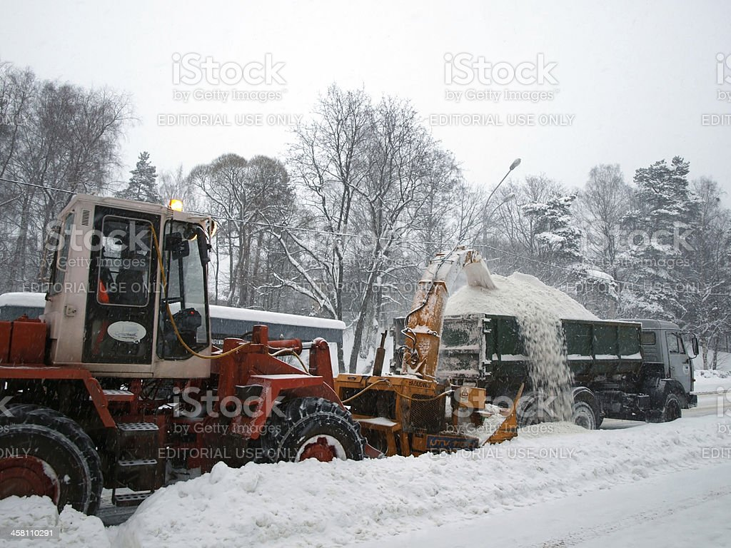Snow removal machines on the road royalty-free stock photo