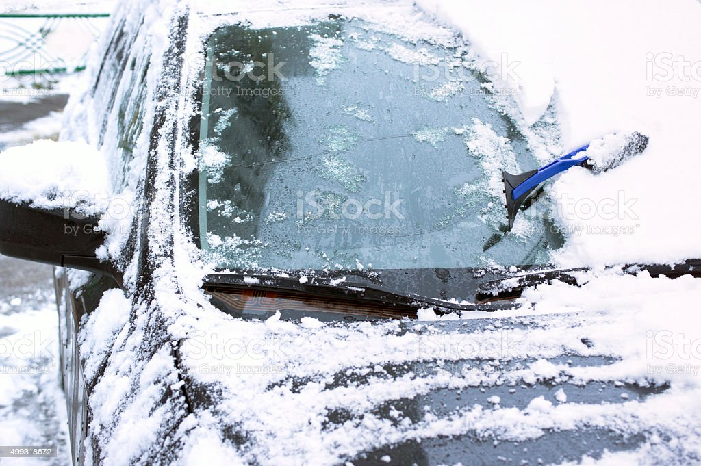 Snow removing from car stock photo