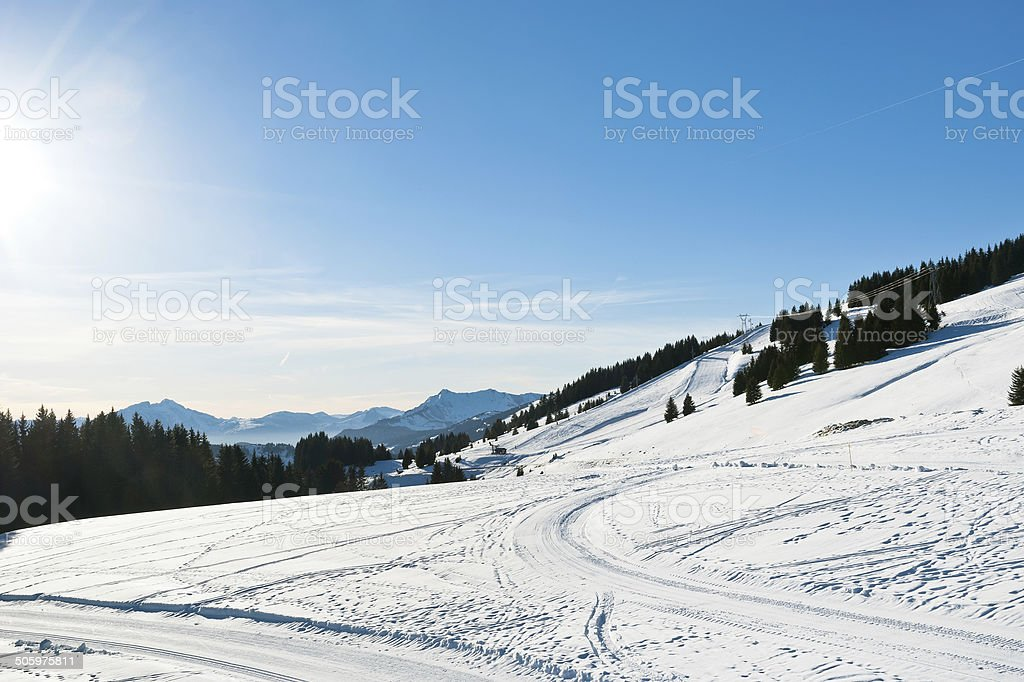 snow road and ski track near Avoriaz town in Alps stock photo