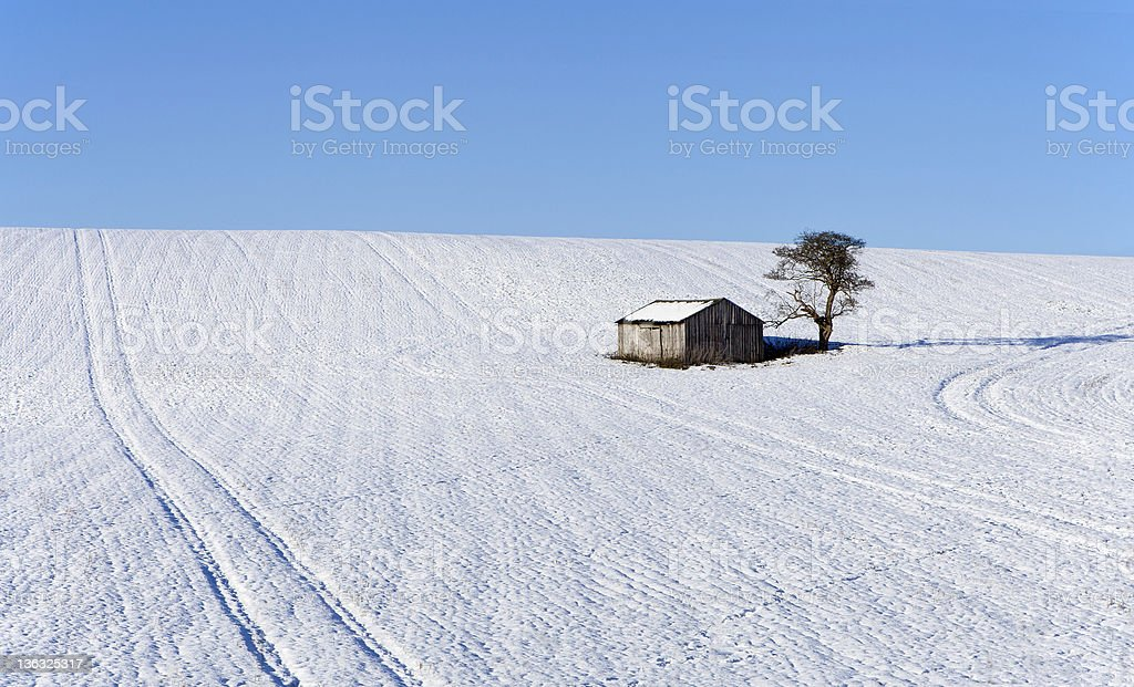 Snow scene with isolated building royalty-free stock photo