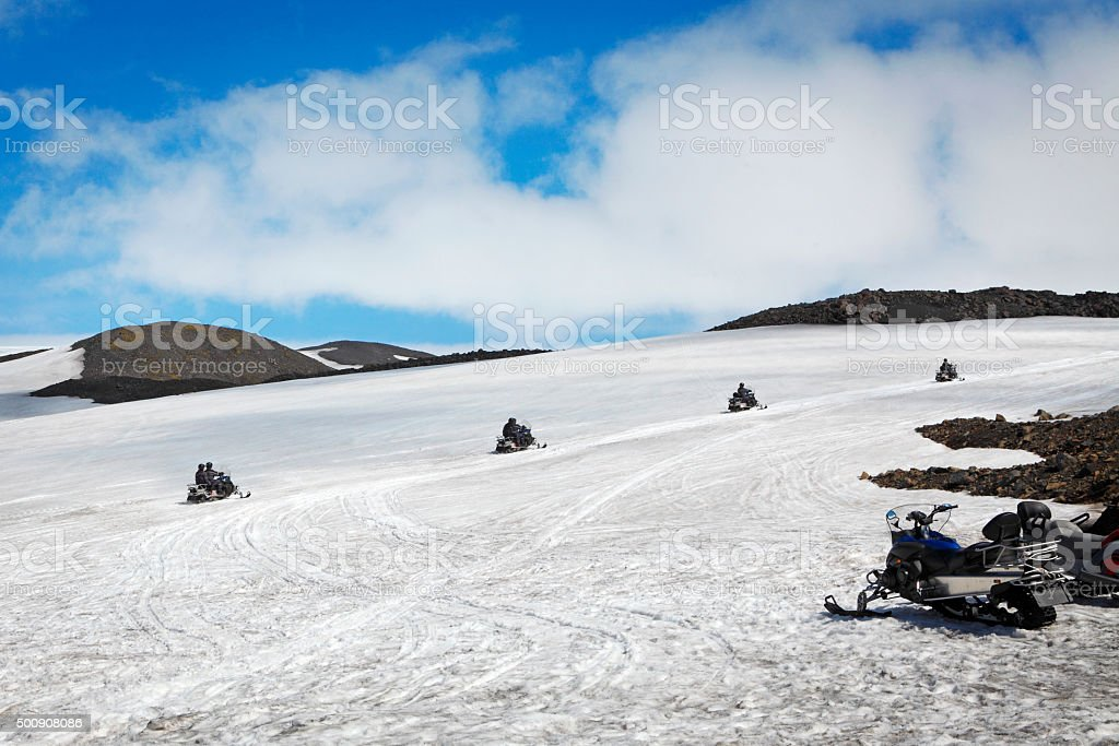Snow scooters at Mýrdalsjökull glacier in Iceland stock photo