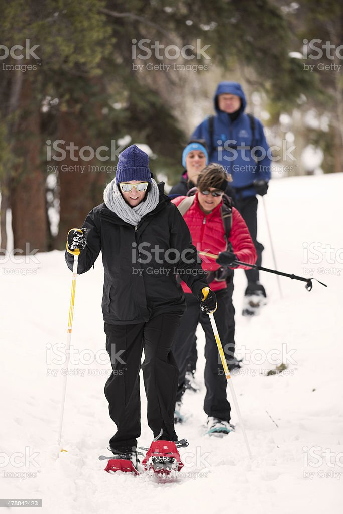 Snow Shoeing Through the Woods stock photo