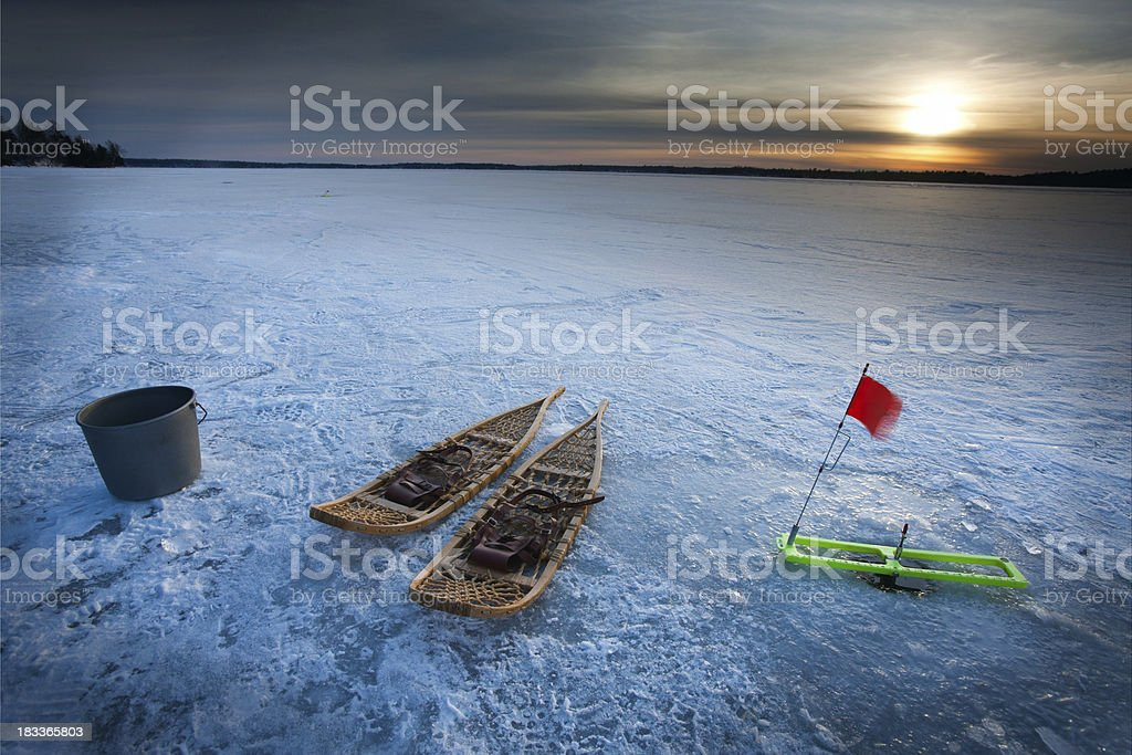snow shoes and tip up on a ice fishing adventure. stock photo