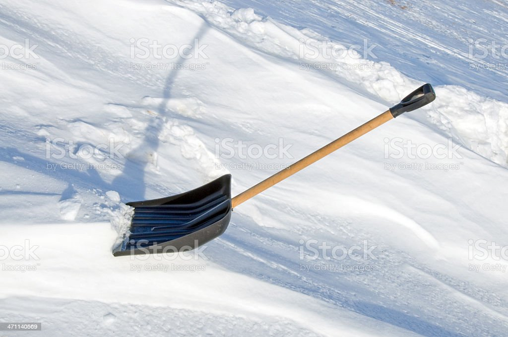 Snow Shovel.. Suspended royalty-free stock photo
