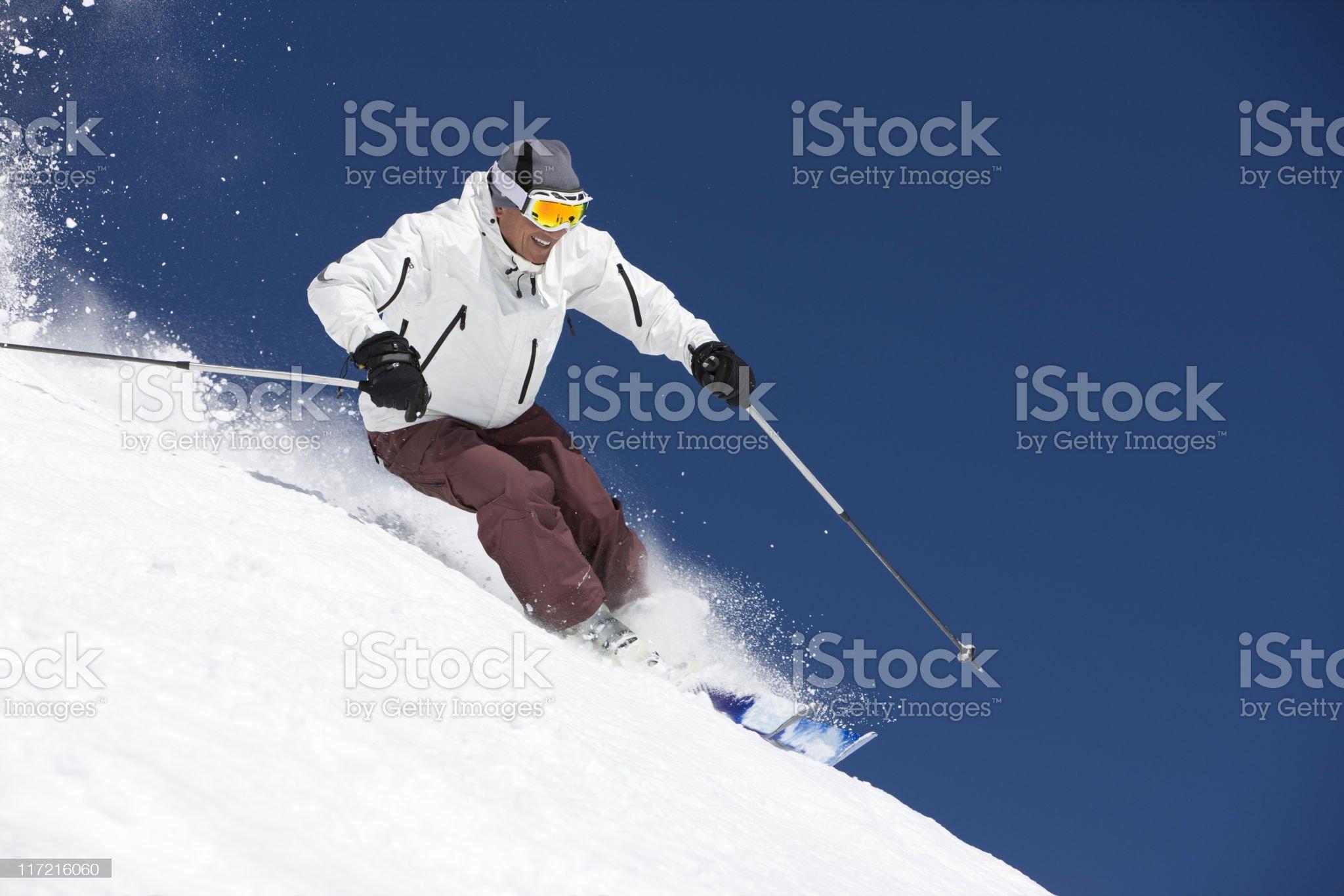 Snow Skier Against Blue Sky royalty-free stock photo