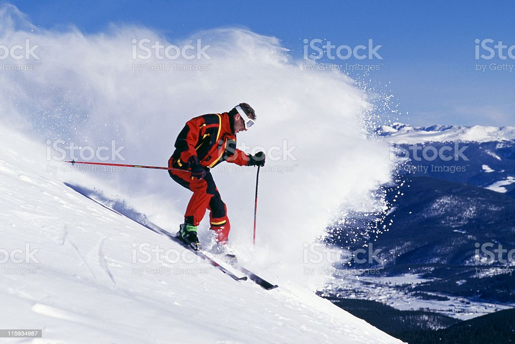 Snow Skier and Wave of Powder stock photo