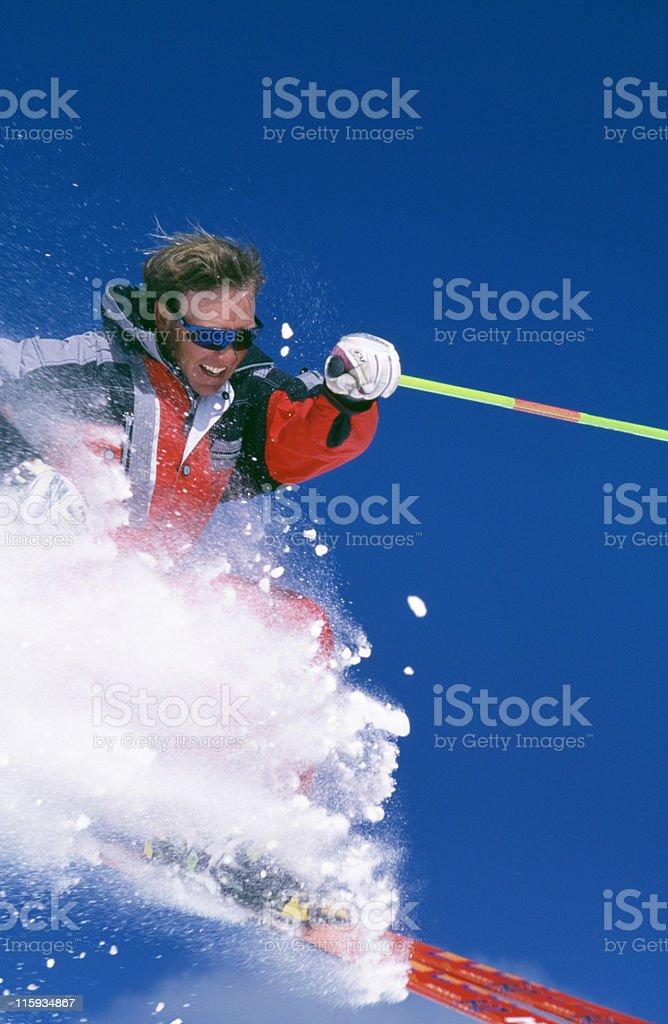 Snow Skier Blasting Through Fresh Powder royalty-free stock photo