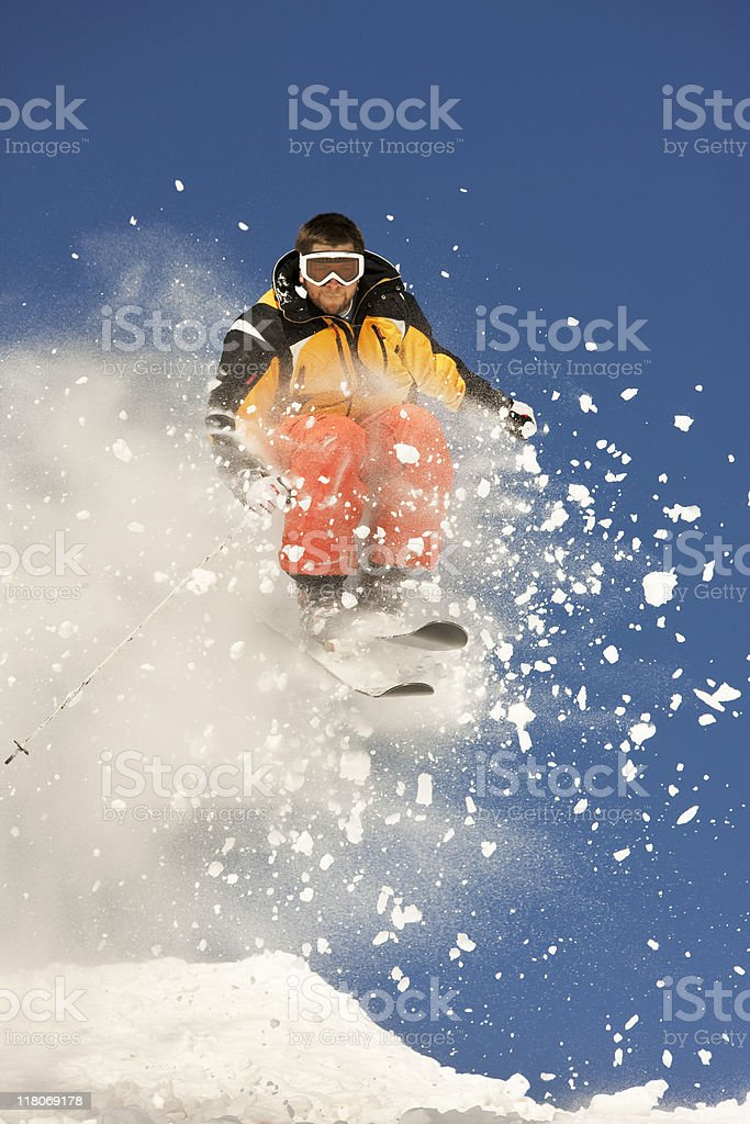 Snow Skier  In Mid Air Against Blue Sky royalty-free stock photo
