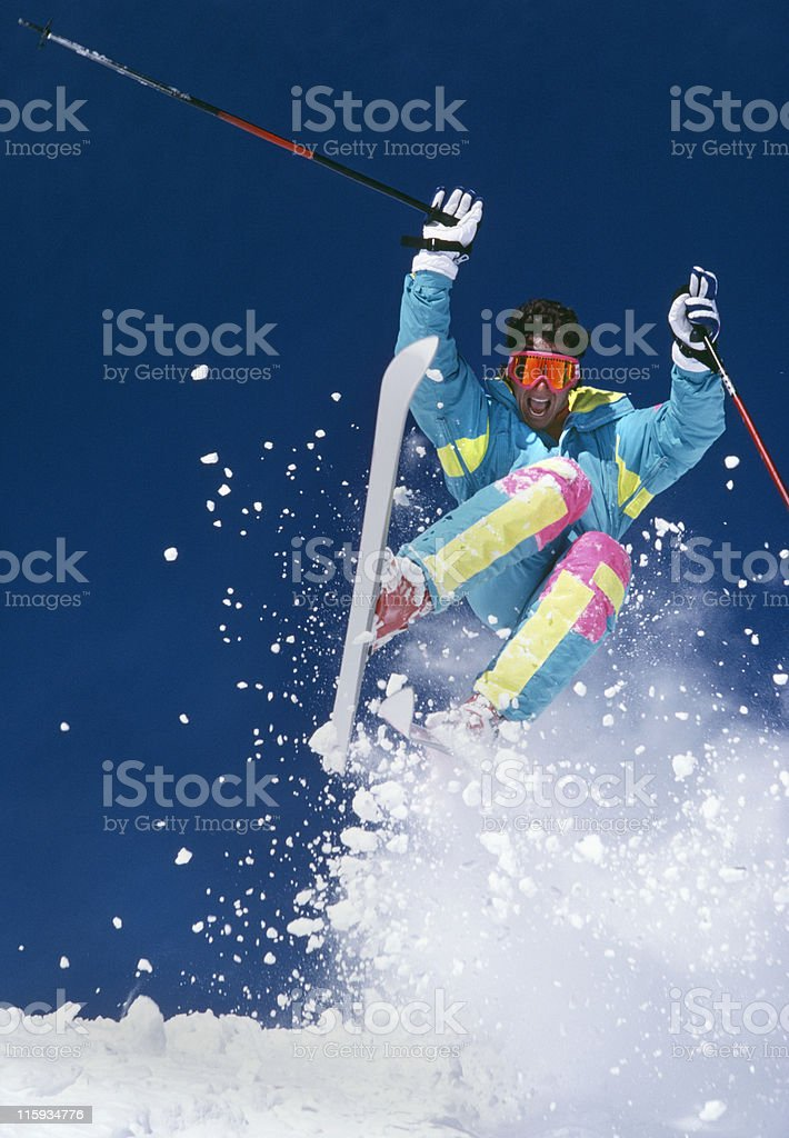 Snow Skier Jumping Against Blue Sky royalty-free stock photo