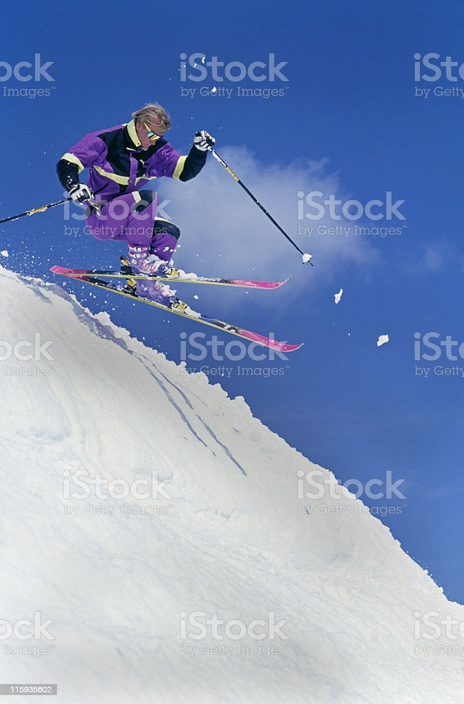 Snow Skier Jumping Off Cornice royalty-free stock photo