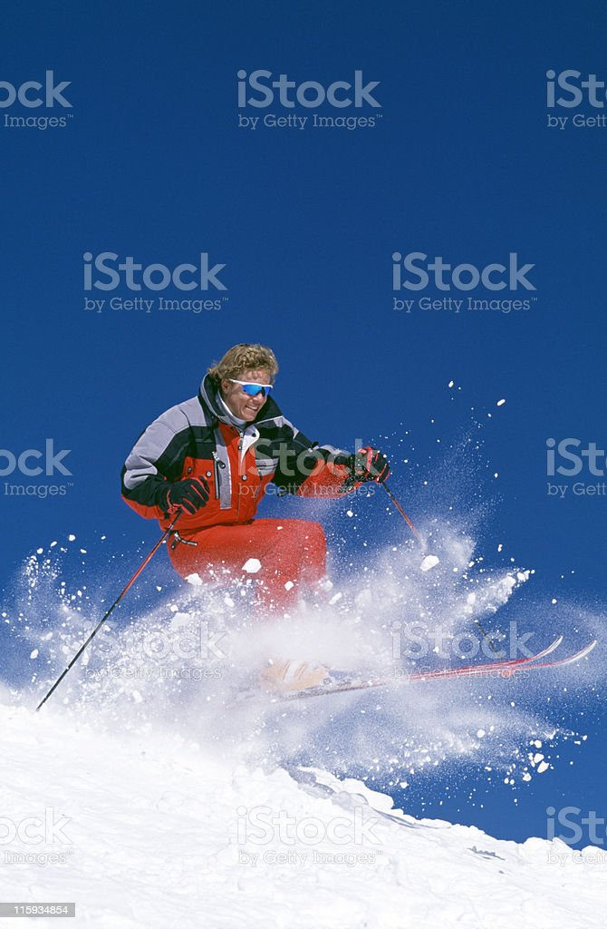 Snow Skier Jumping Over Mogul stock photo
