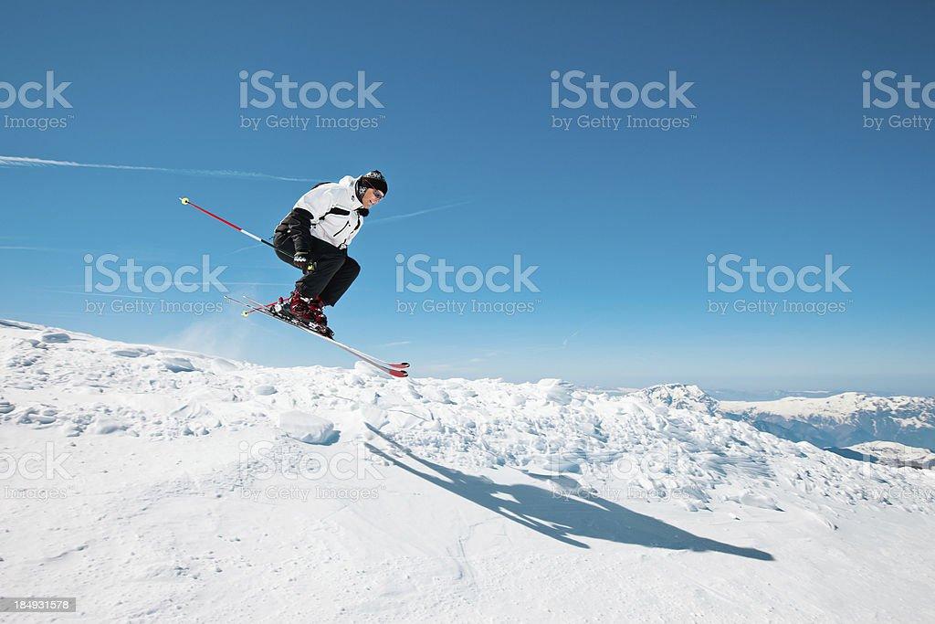 Snow skier jumping stock photo