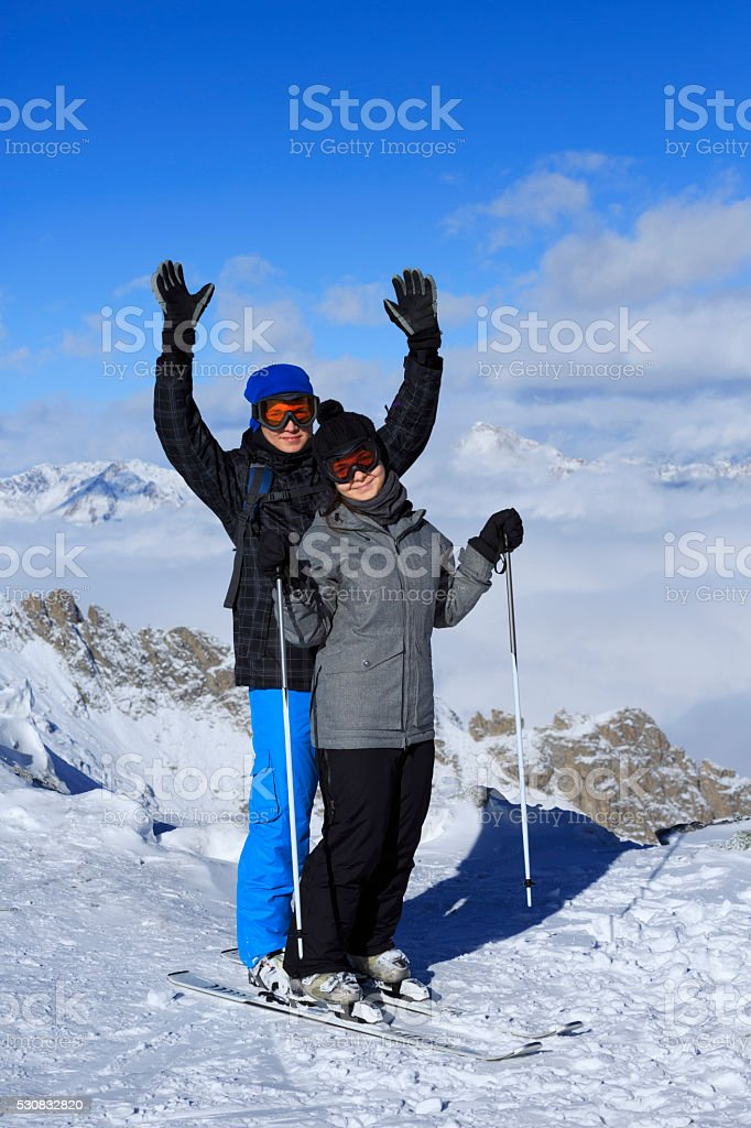 Snow skier   Skiing couple Teen boy and girl enjoying stock photo