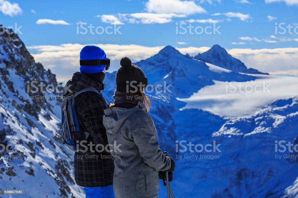 Snow skier   Skiing couple Teen boy and girl enjoying stock photo