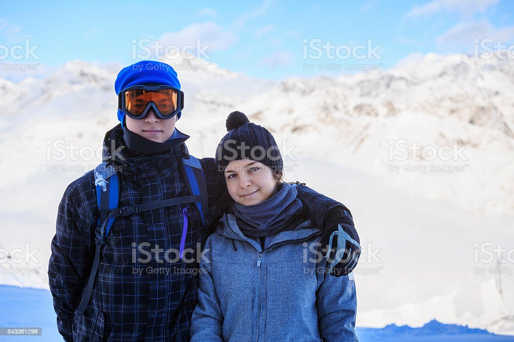 Snow skier   Skiing couple Teen boy and girl enjoying  Winter stock photo