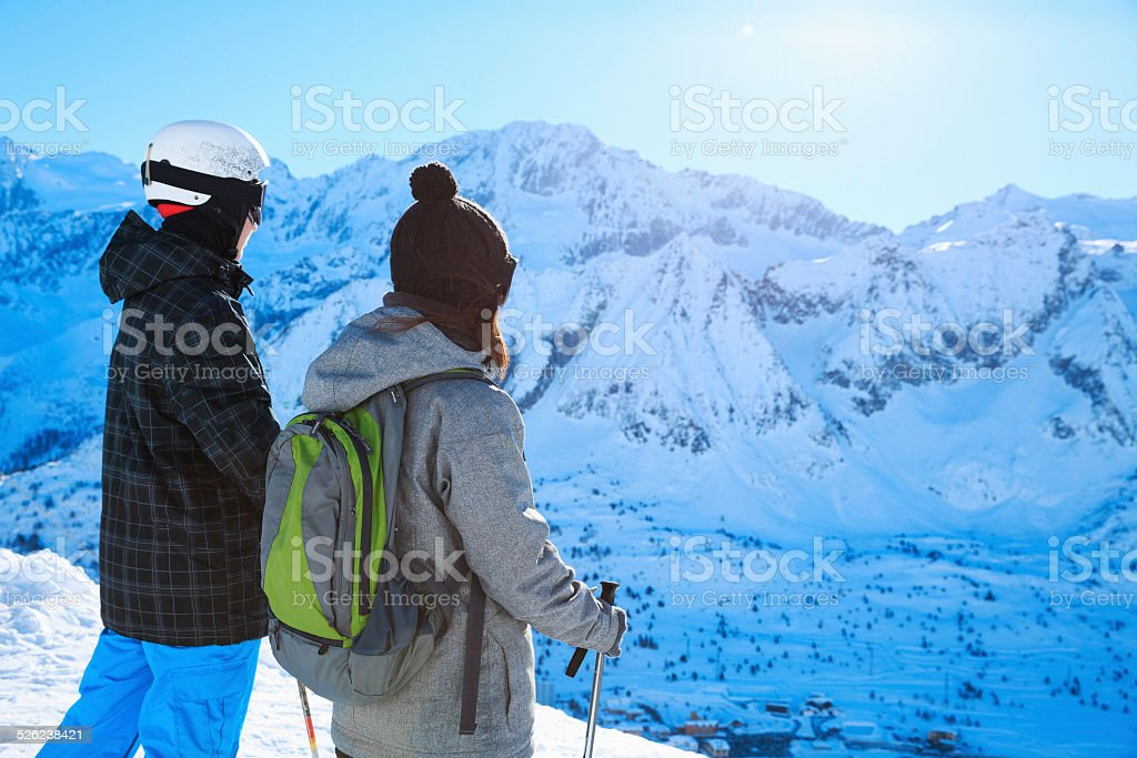Snow skier   Skiing couple Teens boy and girl enjoying stock photo