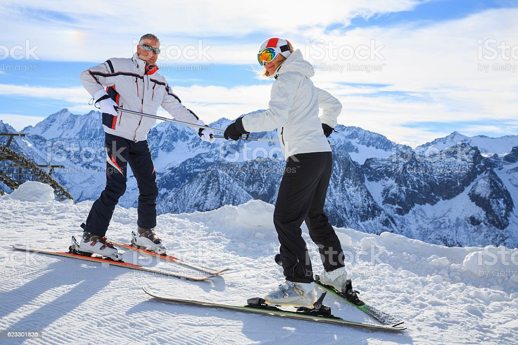 Snow skier women instructor teaching handsome man  Winter snowy mountains stock photo