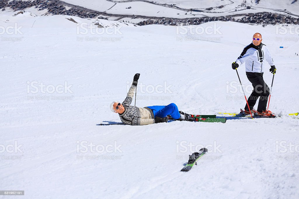 Snow Skiing Accident  Falling stock photo