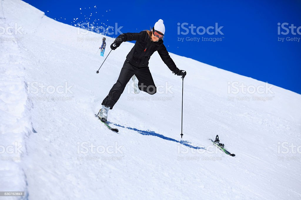 Snow Skiing Accident  Falling   Woman skier skis detaches, loses,  falls stock photo