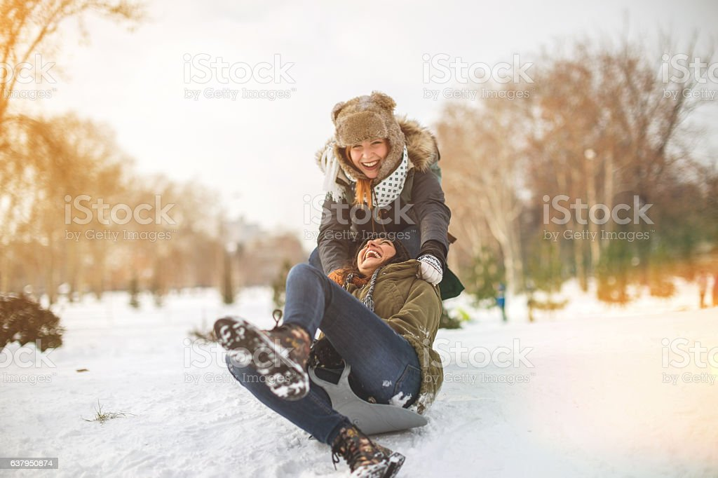 Snow sliding with girlfrend stock photo