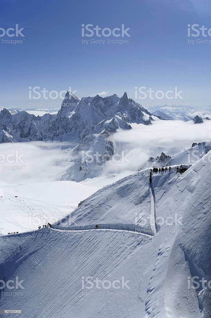 Snow slope with path for mountain-skiers, the Alps royalty-free stock photo