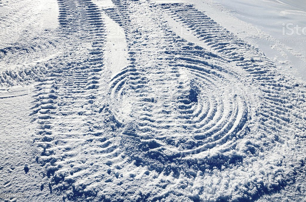 Snow slope with traces of the snowmobile stock photo