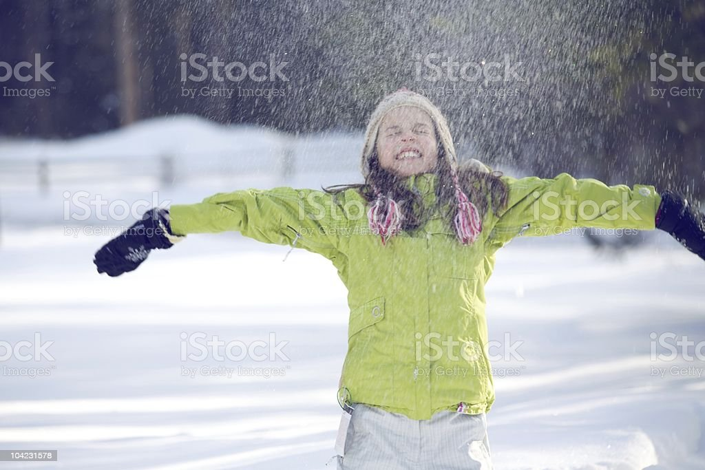 Snow Sprinkling a Girl in Winter stock photo