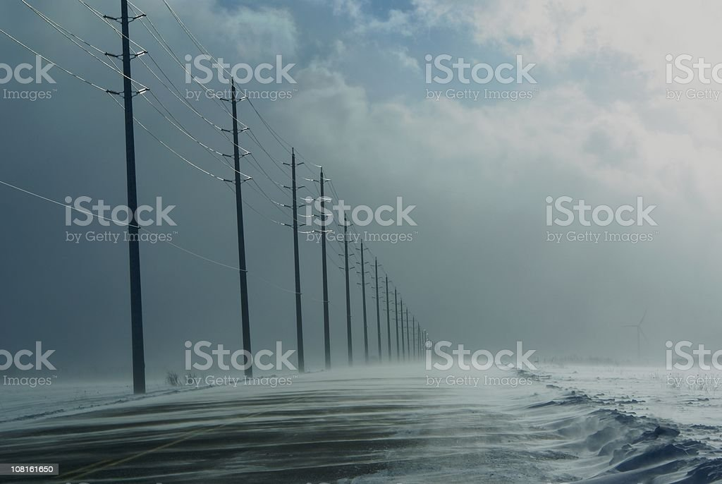 Snow Squalls Covering Rural Highway Road royalty-free stock photo